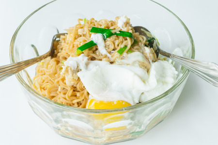 cooked instant noodle: Close up spicy noodle with big egg. Concept food. Stock Photo