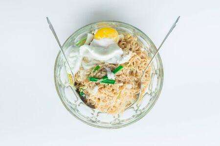 Close up spicy noodle with big egg. Concept food. Stock Photo
