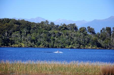 man on a jet ski on a lagoon photo