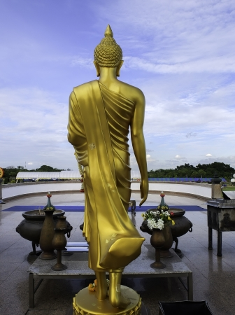 monk: back of golden buddha statue Stock Photo