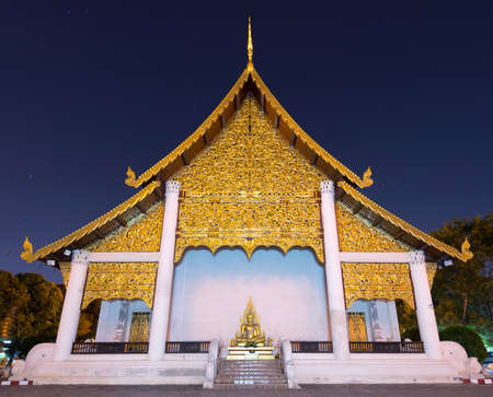 entity: beautiful of Buddhist temple illuminated at night,Chiang Mai