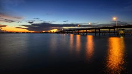 Long bridge to the sea at dusk  photo