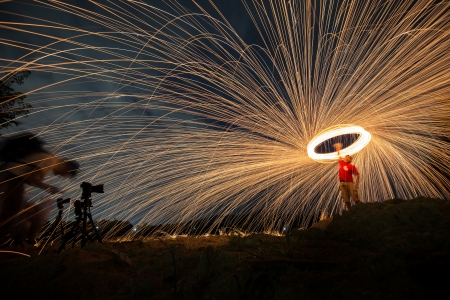 Fire spinning from steel wool photo