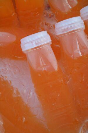 juice bottle: Orange juice bottle  ice cold Stock Photo