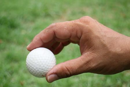 golfball: Golf-ball in hand Stock Photo