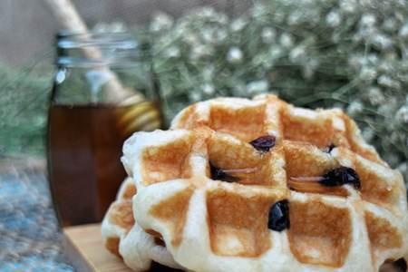 rum cake: Raisin Waffle on wooden plates Stock Photo
