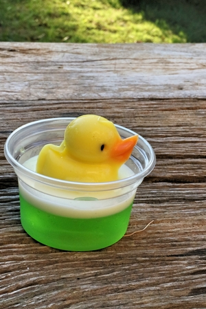 imitations: yellow duck jelly on wooden plates , delicious dessert Stock Photo