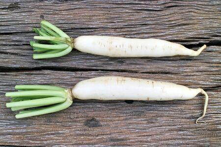 radishes: Radishes on old wood Stock Photo