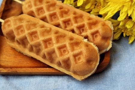 Waffle hotdog on wooden  plates