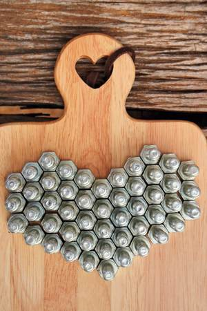 nut arrange as a heart on wood background Stock Photo