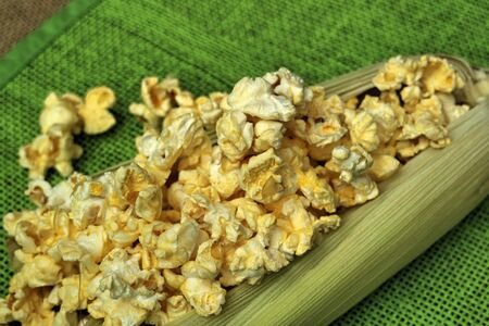 casks: popcorn on the table Green background Stock Photo