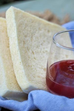 strawberry jam sandwich: slice of fresh white bread with Strawberry Jam Stock Photo