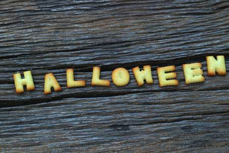 halloween message: Halloween message design on wooden background Stock Photo