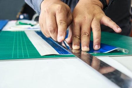 Cutting sticker on the cutting mat. photo
