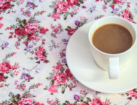coffee  on  table with  rose bouquet  fabric as background photo