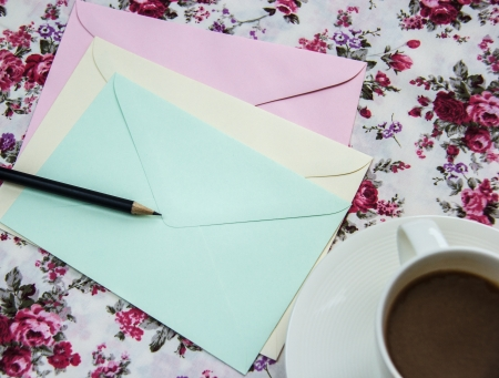Blank envelopes on the table with pencil and coffee cup photo