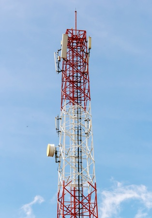 Telecommunications tower with satellite dish , Bule sky Background photo