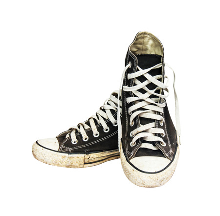 black sneakers isolated on a white background , with clipping path photo