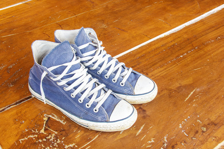 Blue sneakers on the wooden floor  photo