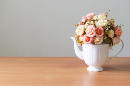 Romantic  a bouquet of roses in white  jug on wooden table photo