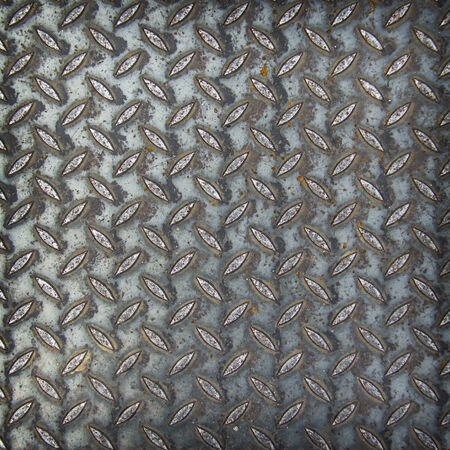 Metal rhombus shaped background and texture photo