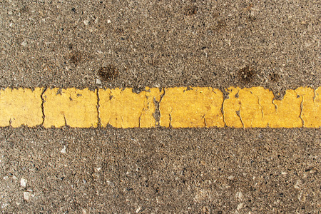 roadway background old texture with yellow line , rough asphalt. Reklamní fotografie
