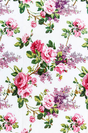 Rose Fabric background, Fragment of colorful retro tapestry textile pattern with floral ornament useful as background Foto de archivo