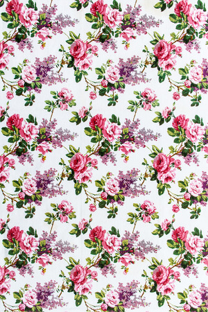 Rose Fabric background, Fragment of colorful retro tapestry textile pattern with floral ornament useful as background photo