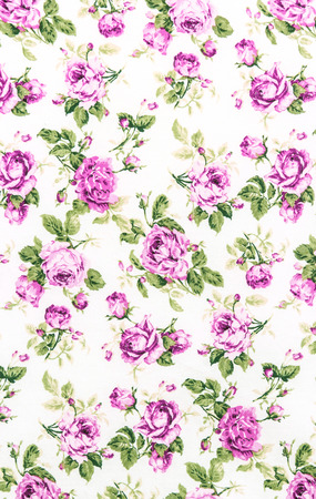 Purple Rose Fabric background, Fragment of colorful retro tapestry textile pattern with floral ornament useful as background. photo