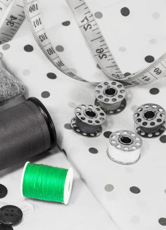 zip tie: green thread spool , Sewing utensils gray color. Stock Photo