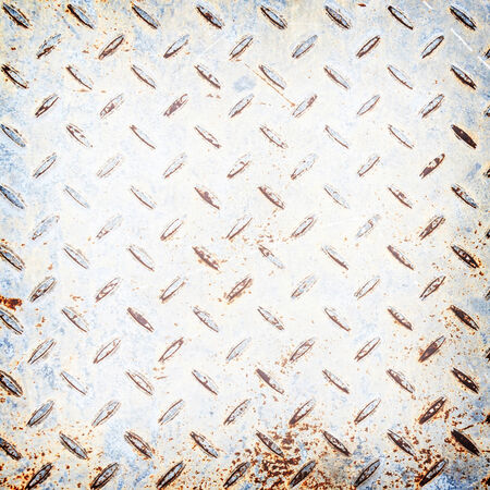 Metal rhombus shaped background and texture , with rust. photo