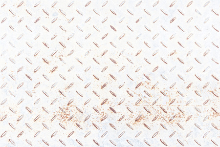 White metal rhombus shaped background and texture , with rust photo