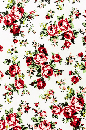 Red Rose Fabric background, Fragment of colorful retro tapestry textile pattern with floral ornament useful as background photo
