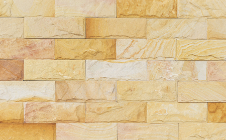 sand stone wall texture and ackground of decorate photo