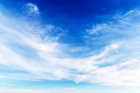 幻想的な柔らかな白い雲と青い空 写真素材