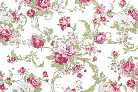 red rose on white fabric background, Fragment of colorful retro tapestry textile pattern with floral ornament useful as background. photo