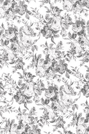 Gray rose on white fabric background, Fragment of colorful retro tapestry textile pattern with floral ornament useful as background.