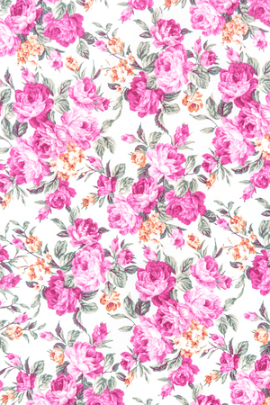 Pink rose fabric background, Fragment of colorful retro tapestry textile pattern with floral ornament useful as background. photo