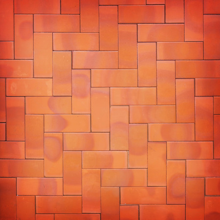 ���wall tiles���: Brown wall tiles as a background or texture.