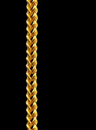 Gold chain necklace isolated on black, closeup , clipping path. photo