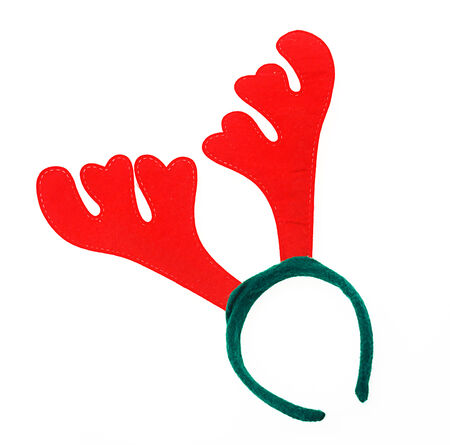 Pair of toy reindeer horns. Isolated on a white background. photo