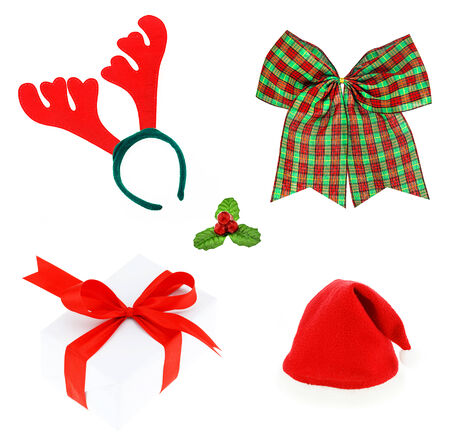 Christmas set & Accessories. isolated on white background, Pair of toy reindeer horns,   bow,  Holly berry , gift , santa hat. photo