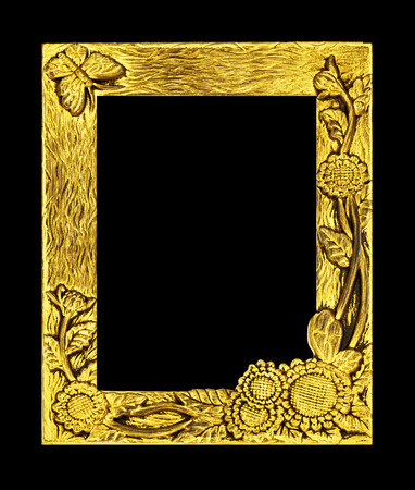 antique golden frame isolated on black background,  sunflower and butterfly tracery photo
