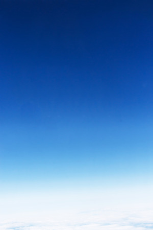 clear day: Fantastic soft white clouds against blue sky, take a picture on the airplane.