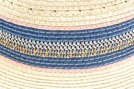 latticework: Woven straw background or texture. Brown blue  pink  yellow color.