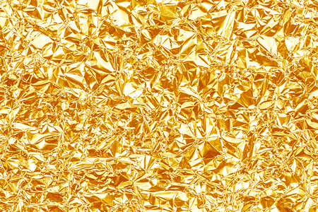 crease: Shiny yellow gold foil texture for background and shadow. Crease. Stock Photo