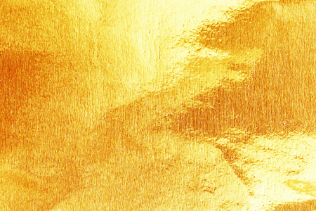 shiny gold: Shiny yellow gold foil texture for background.