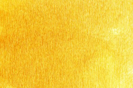 unruffled: Shiny yellow gold foil texture for background. and shadow.