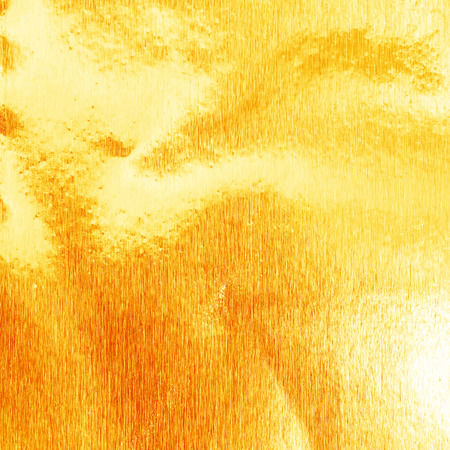 unruffled: Shiny yellow gold foil texture for background. and shadow