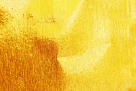 unruffled: Shiny yellow gold foil texture for background and shadow. Gold  background . Gold metal